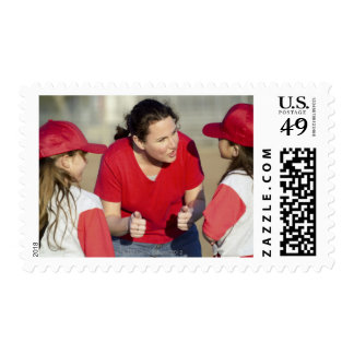 Coach with little league players postage