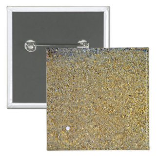 Coarse yellow sand for texture pinback button