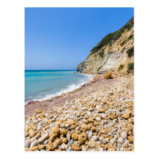 Coast landscape with stony beach and blue sea postcard
