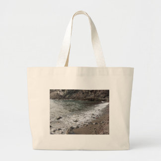 Coast with stones and sea in Livorno Large Tote Bag