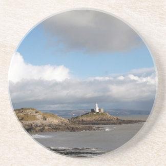 Coastal landscape and lighthouse drink coaster