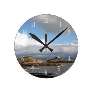Coastal landscape and lighthouse round clock