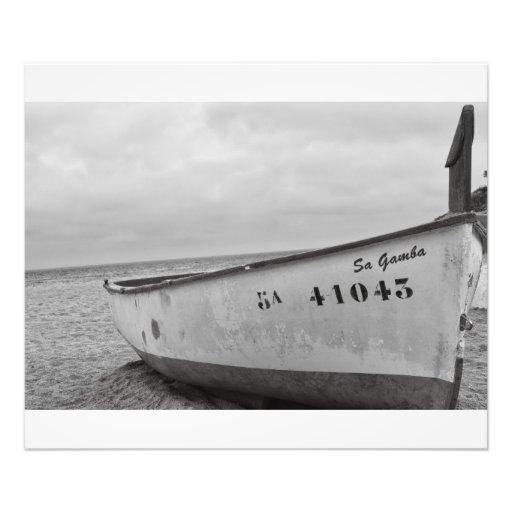 Coastal small fishing boat on the beach photographic print