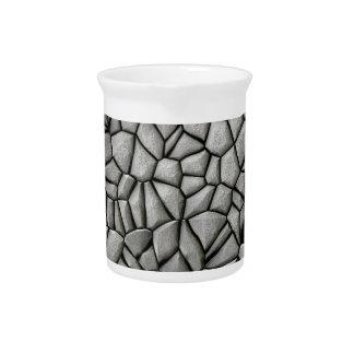 Cobble stones surface beverage pitcher