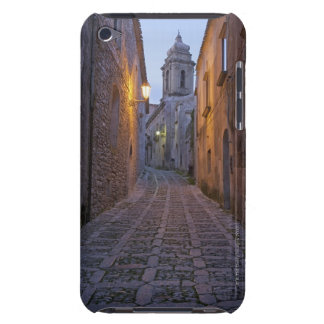 Cobbled alleyway of old city lit up at night iPod touch case