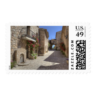 Cobblestone street, stone buildings, historic stamp