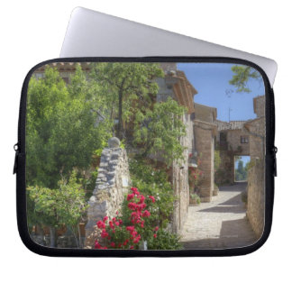 Cobblestone streets, historic stone buildings. laptop computer sleeves