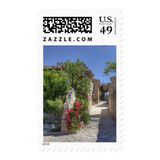 Cobblestone streets, historic stone buildings. postage stamp