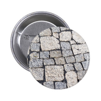 Cobblestones of a street in detail button