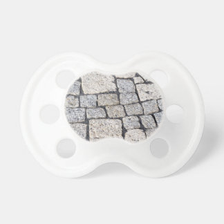 Cobblestones of a street in detail pacifier