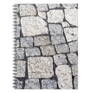 Cobblestones of a street in detail spiral notebook
