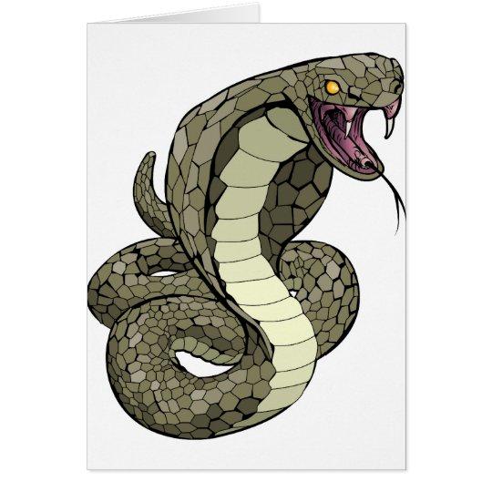 Cobra snake about to strike card