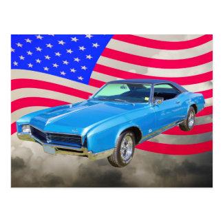 Coche 1967 del músculo de Buick Riviera y bandera  Postal