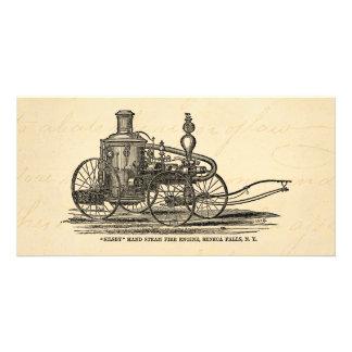 Coche de bomberos de la antigüedad del coche de tarjeta fotografica