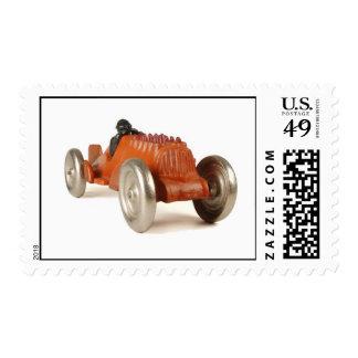 Coche de carreras del naranja del vintage sellos
