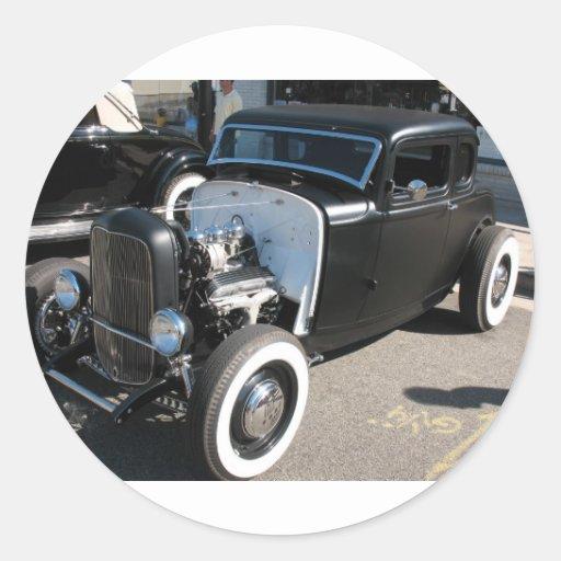Coche de carreras negro del vintage etiqueta