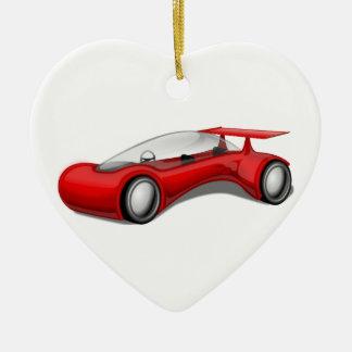 Coche futurista aerodinámico rojo brillante con el adorno navideño de cerámica en forma de corazón