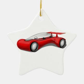 Coche futurista aerodinámico rojo brillante con el adorno navideño de cerámica en forma de estrella