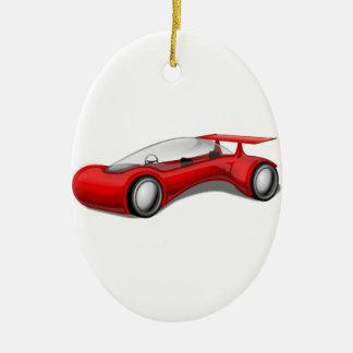 Coche futurista aerodinámico rojo brillante con el adorno navideño ovalado de cerámica