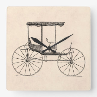 Cochecillo antiguo traído por caballo del carro de reloj cuadrado