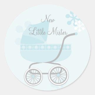 Cochecillo de bebé azul suave etiquetas redondas