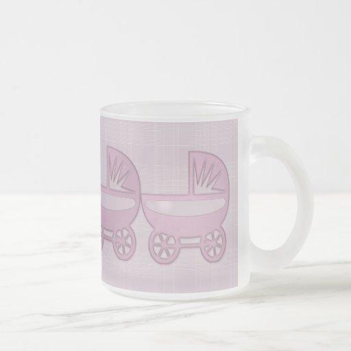 cochecillo de bebé gemelo rosado tazas