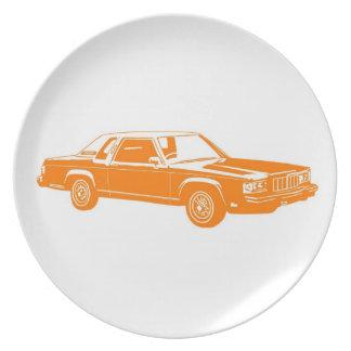 coches del americano de los años 80 plato de cena