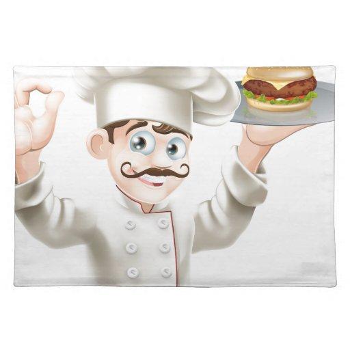 Cocinero con la hamburguesa manteles