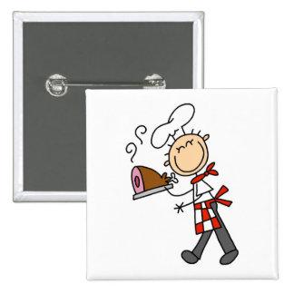 Cocinero con las camisetas y los regalos cocidos d pin