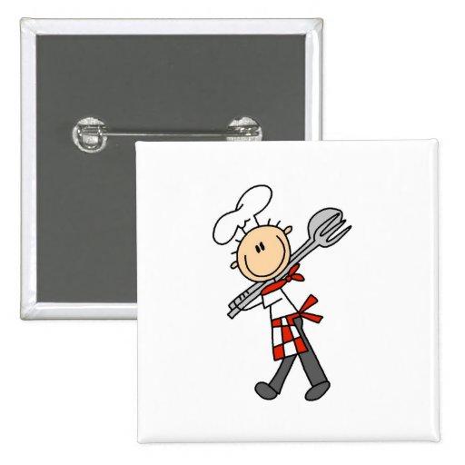 Cocinero con los botones de las pinzas de la ensal