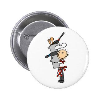 Cocinero con los potes y los botones de las cacero pins