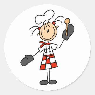 Cocinero de sexo femenino con las camisetas y los pegatina redonda