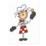 Cocinero de sexo femenino con las camisetas y los  postal