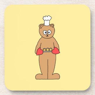 Cocinero del panadero con los Cupcakes. Posavasos