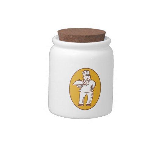 Cocinero del panadero del cocinero con el disco jarra para caramelo