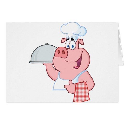 Cocinero feliz del cerdo que lleva a cabo una mues tarjeta de felicitación