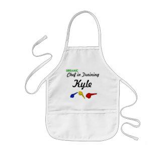 Cocinero orgánico en el entrenamiento delantal infantil