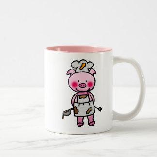 Cocinero rosado del cerdo del dibujo animado taza