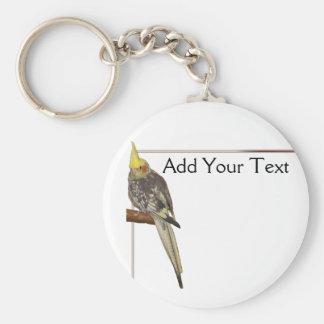Cockatiel de varios colores en una rama con blanco llavero personalizado