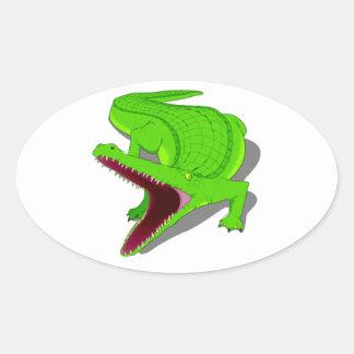 Cocodrilo del dibujo animado con su boca abierta pegatina de óval personalizadas