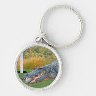 Cocodrilo, mentira peligrosa del golf llavero redondo plateado
