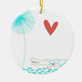 Cocodrilo minimalista con la flor del corazón y de adorno navideño redondo de cerámica
