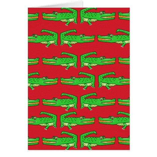 Cocodrilos verdes en rojo felicitación