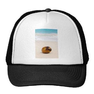 Coconut on a tropical beach trucker hat