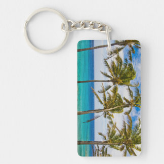 Coconut palm trees (Cocos nucifera) swaying in Keychain