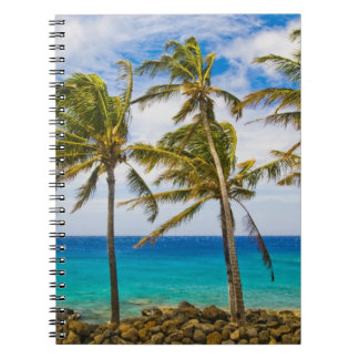 Coconut palm trees (Cocos nucifera) swaying in Spiral Notebook