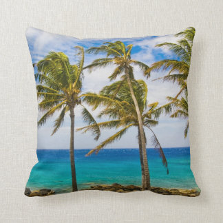 Coconut palm trees (Cocos nucifera) swaying in Throw Pillow