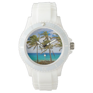 Coconut palm trees (Cocos nucifera) swaying in Wrist Watch