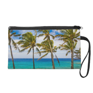 Coconut palm trees (Cocos nucifera) swaying in Wristlet Purse