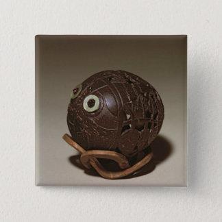 Coconut sculpted into a face, c.1895 button